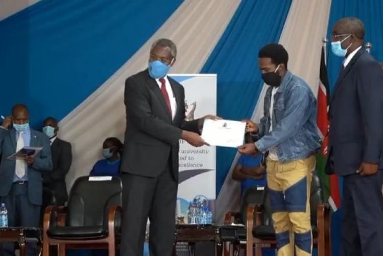 The Uon Rugby Captain Marvin Receives an Award from the UoN Vc